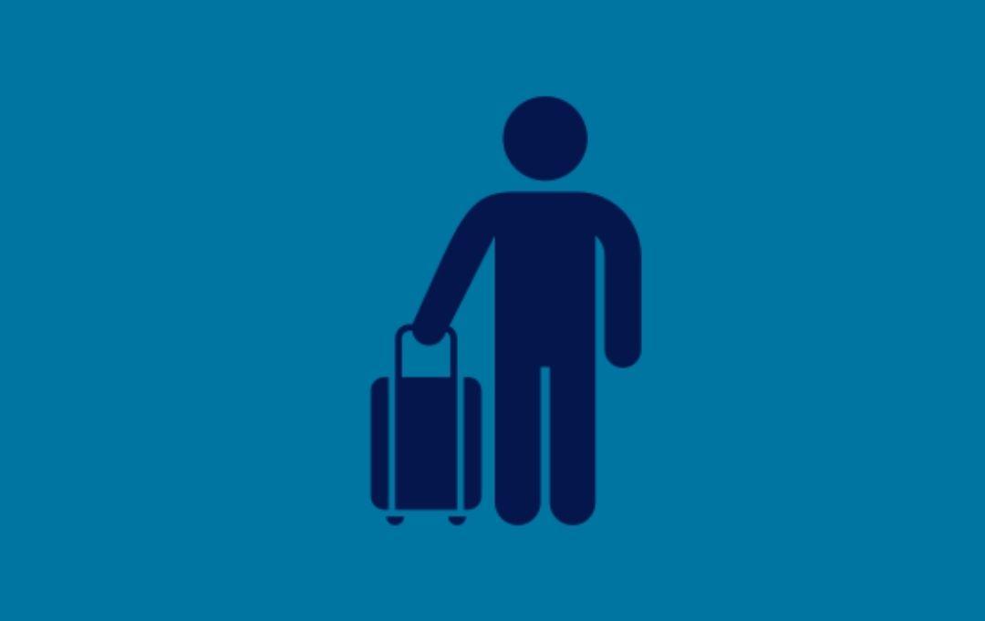 Symbol Reisender mit Koffer